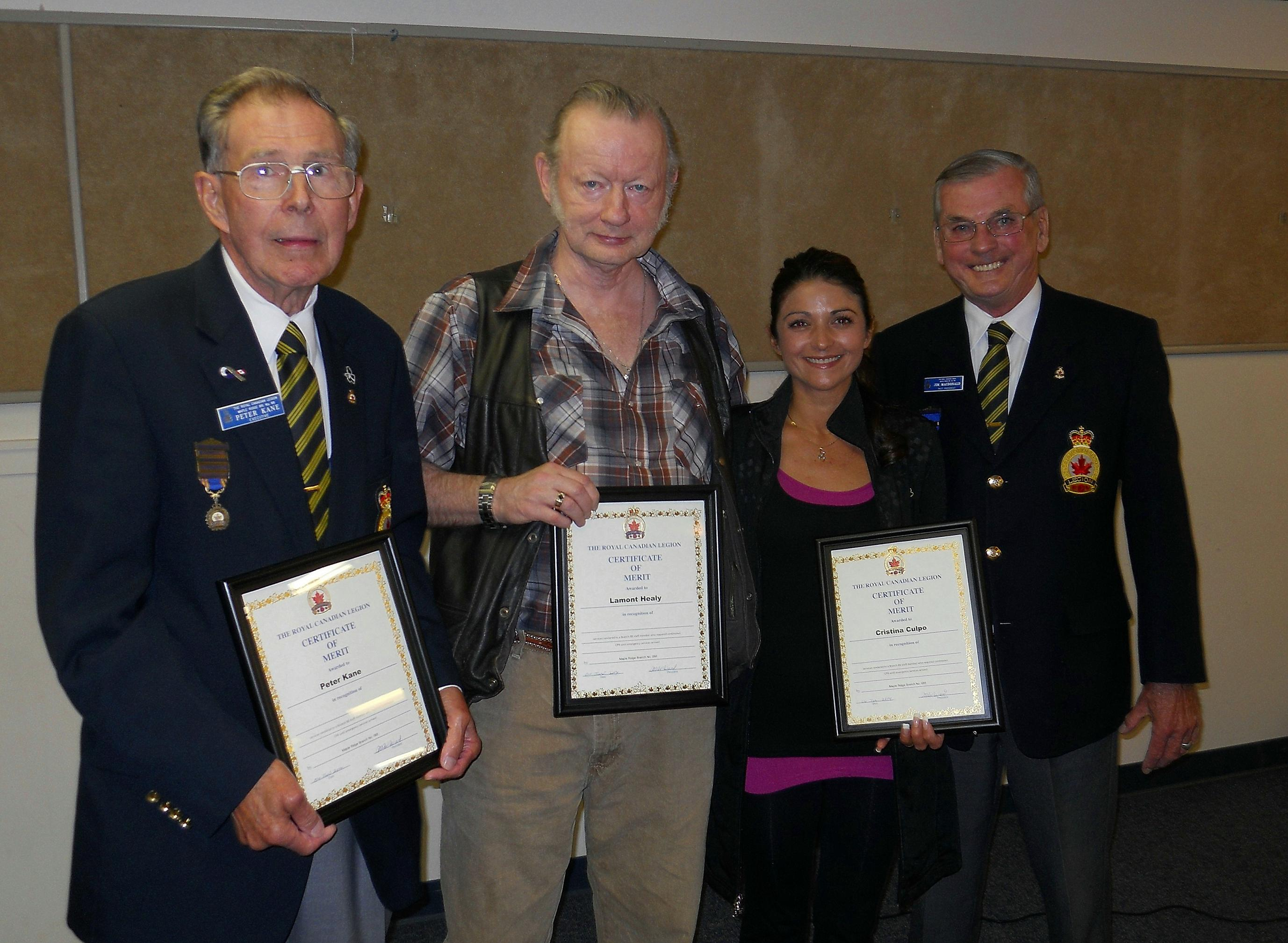 Peter Kane, Lamont Healy and Cristina Culpo each received the Royal Canadian Legion Certificate of Merit from Past President Jim MacDonald. This honours their outstanding efforts in providing continuous life-saving CPR to a staff member until Emergency Services arrived. Not shown in the photo is the fourth recipient, Phillis Douglas.
